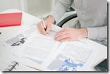 Businessman analyzing economic documents